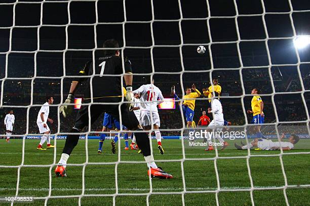 Juan of Brazil heads in his side's first goal from a corner past Claudio Bravo of Chile during the 2010 FIFA World Cup South Africa Round of Sixteen...