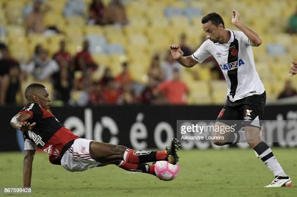 Juan of Flamengo battles for the ball with Nenê of Vasco da Gama during the match between Flamengo and Vasco da Gama as part of Brasileirao Series A...