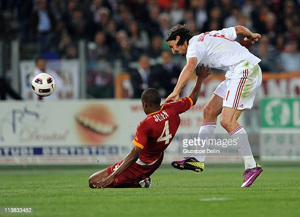 Juan of Roma and Zlatan Ibrahimovic of Milan in action during the Serie A match between AS Roma and AC Milan at Stadio Olimpico on May 7 2011 in Rome...