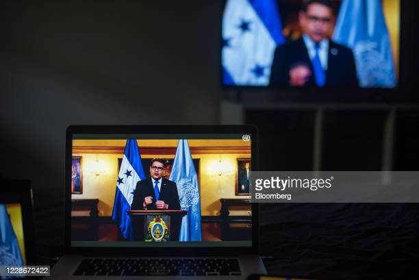 Juan Orlando Hernandez, Honduras' president, speaks during the United Nations General Assembly seen on a laptop computer in Hastings on the Hudson,...