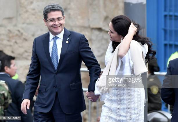 Juan Orlando Hernandez, president of Honduras, and his wife, Ana Garcia, arrive the ceremony where Ivan Duque Takes Office as the new president of...