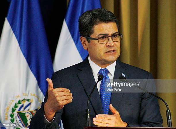 Juan Orlando Hernandez President of Honduras gives an speech during a meeting on August 23, 2016 in San Salvador, El Salvador. Presidents of the...