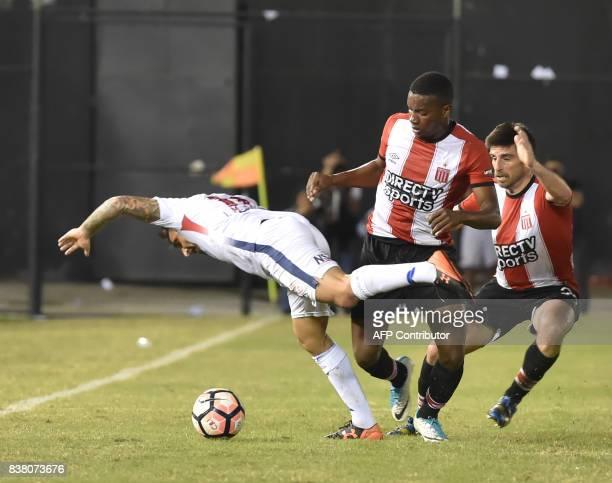 Juan Otero of Argentinas Estudiantes de la Plata vies for the ball with Carlos Bonet of Paraguay's Nacional during their 2017 Copa Sudamericana...