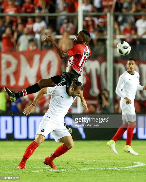 Juan Otero of Estudiantes and Gaston Silva of Independiente fight for the ball during the match between Independiente and Estudiantes as part of the...