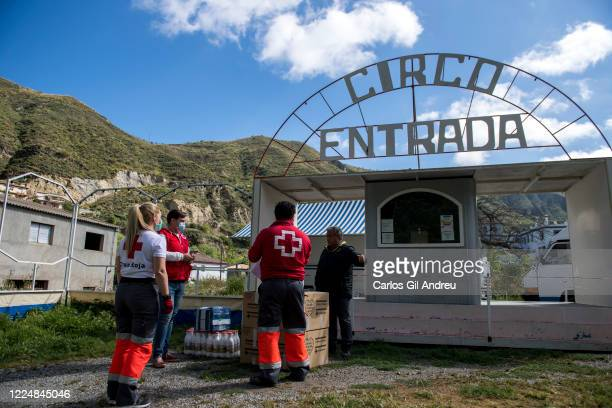 Juan owner of a traveling circus trapped in Pinos Genil due to the state of emergency talks to the Red Cross volunteers as they leave aid boxes for...