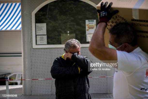 Juan owner of a traveling circus trapped in Pinos Genil due to the state of alarm cries as a Red Cross volunteer unloads aid boxes for him on May 13...