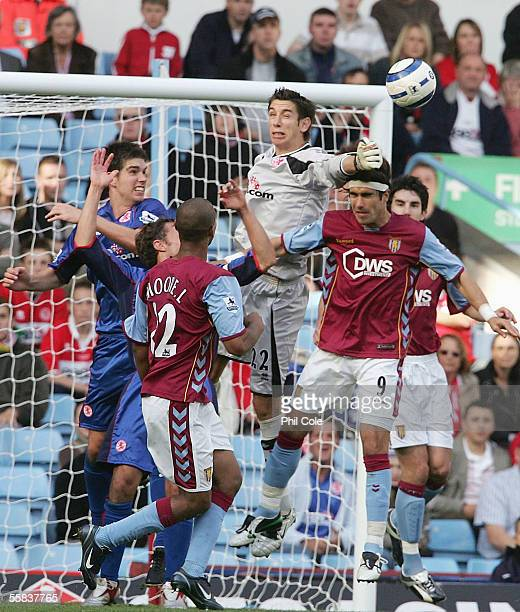 Juan Pablo Angel of Aston Villa goes up for the ball against Brad Jones of Middlesbrough during the Barclays Premiership match between Aston Villa...