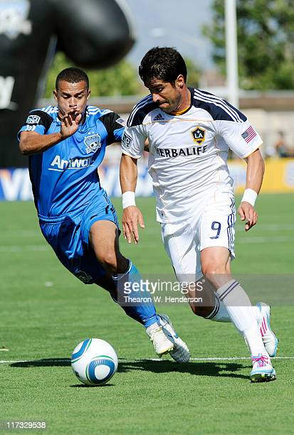 Juan Pablo Angel of the Los Angeles Galaxy battle for the ball with Jason Hernandez of the San Jose Earthquakes during an MLS soccer game at Buck...
