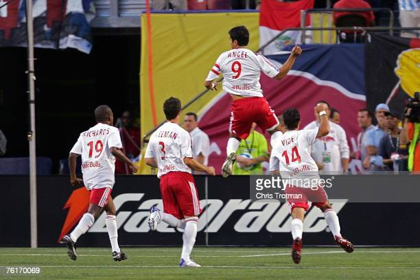 Juan Pablo Angel of the New York Red Bulls celebrates with his team after scoring a goal in the first half against the Los Angeles Galaxy at Giants...