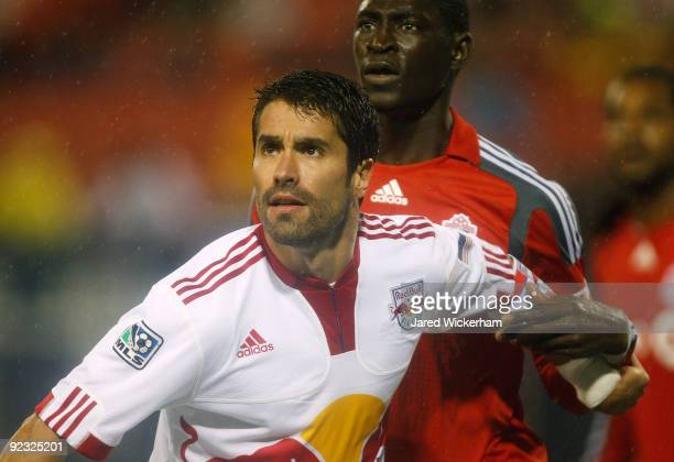Juan Pablo Angel of the New York Red Bulls fights for position against Emmanuel Gomez of the Toronto FC during the game against the on October 24...