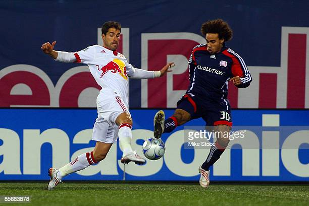 Juan Pablo Angel of the New York Red Bulls fights for possession of the ball against Kevin Alston of the New England Revolution during the game at...