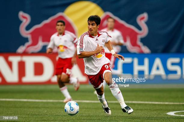 Juan Pablo Angel of the New York Red Bulls handles the ball against the New England Revolution on July 14 2007 at Giants Stadium in East Rutherford...