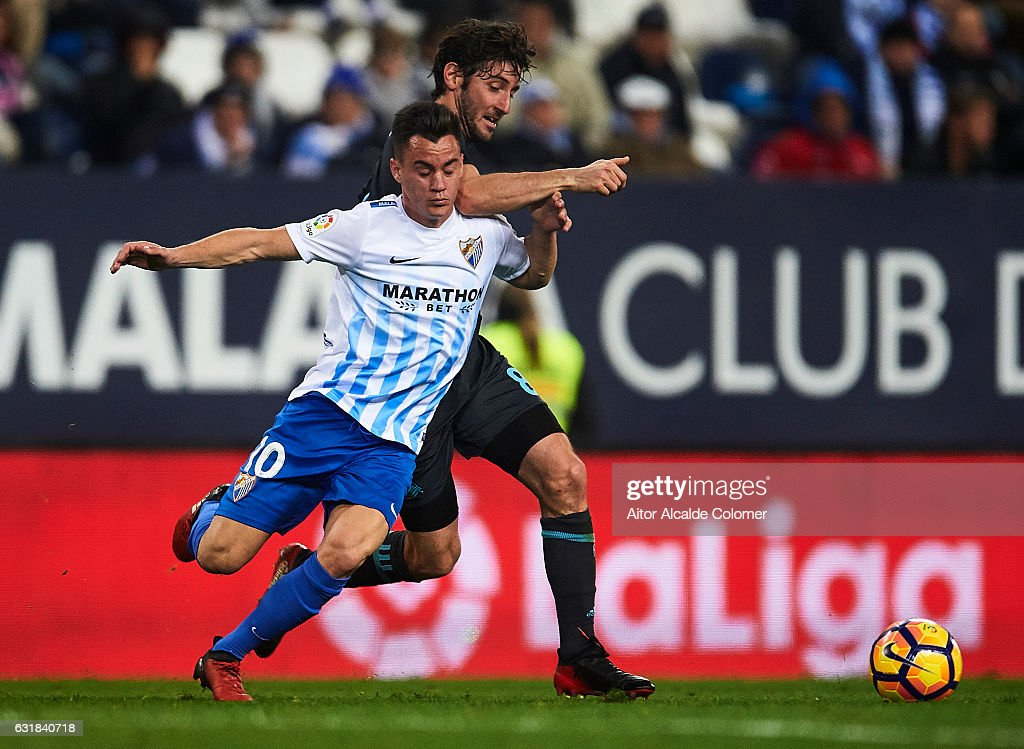 Juan Pablo Anor 'Juanpi' of Malaga CF (L) competes for the ball with Esteban Granero of Real Sociedad (R) during the La Liga match between Malaga CF and Real Sociedad de Futbol at La Rosaleda Stadium on January 16, 2017 in Malaga, Spain.