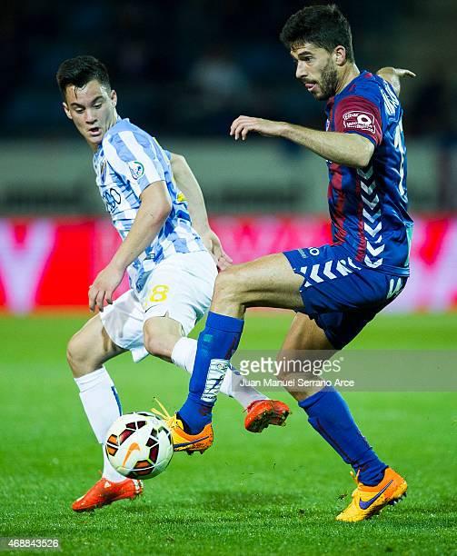 Juan Pablo Anor of Malaga FC duels for the ball with Didac Vila of SD Eibar during the La Liga match between SD Eibar and Malaga FC at Ipurua...