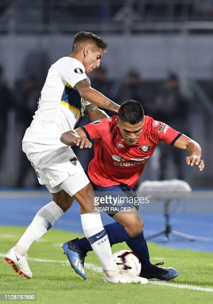 Juan Pablo Aponte of Bolivia's Wilstermann vies for the ball with Agustin Almendra of Argentina's Boca Juniors during their Copa Libertadores...