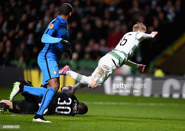 Juan Pablo Carrizo of FC Internazionale and Gary Mackay Steven of Celtic compete for the ball during the UEFA Europa League Round of 32 match between...