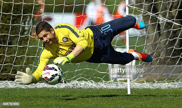 Juan Pablo Carrizo of FC Internazionale Milano dives to save a shot during an FC Internazionale training session at the club's training ground on...