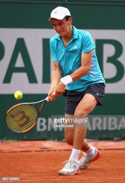 Juan Pablo Grassi Mazzuchi of Argentina plays a forehand during the boys singles first round match against Matteo Martineau of France on day eight of...