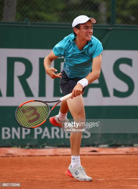 Juan Pablo Grassi Mazzuchi of Argentina serves during the boys singles first round match against Matteo Martineau of France on day eight of the 2017...
