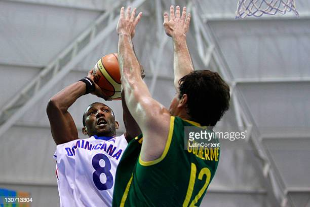 Juan Pablo Montas of Dominican Republic and Guilherme Giovannoni of Brazil in action during a basketball match as part of the XVI Pan American Games...