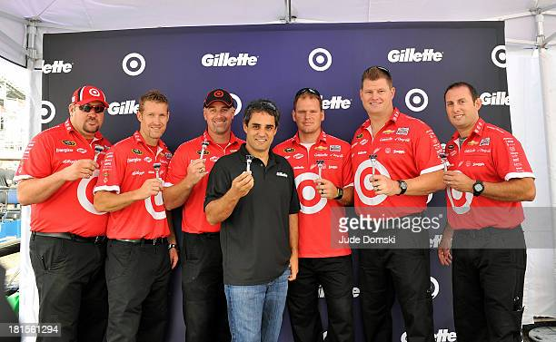 Juan Pablo Montoya driver of the No 42 Target car and his pit crew show off their newly smooth faces after a Gillette shaveoff at the NASCAR Sprint...