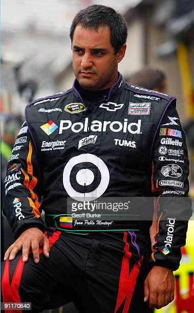Juan Pablo Montoya driver of the Polaroid Chevrolet waits in the garage area during practice for the NASCAR Sprint Cup Series AAA 400 at Dover...
