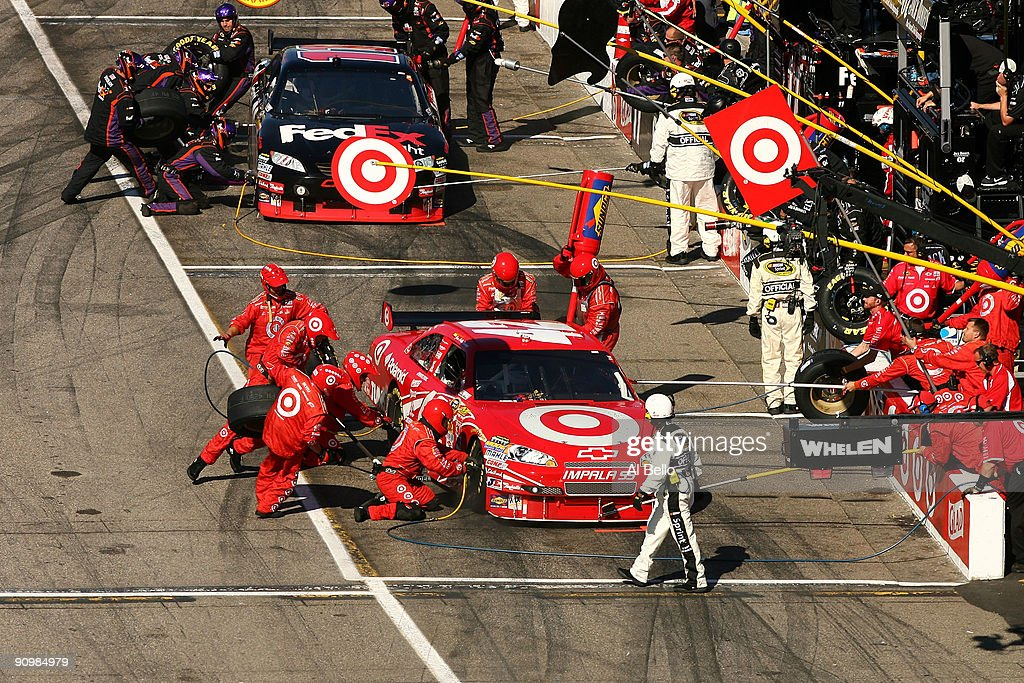 Juan Pablo Montoya, driver of the #42 Target Chevrolet and Denny Hamlin, driver of the #11 FedEx Freight Toyota, make a pit stop during the NASCAR Sprint Cup Series Sylvania 300 at the New Hampshire Motor Speedway on September 20, 2009 in Loudon, New Hampshire.
