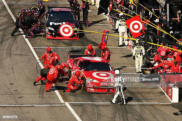 Juan Pablo Montoya driver of the Target Chevrolet and Denny Hamlin driver of the FedEx Freight Toyota make a pit stop during the NASCAR Sprint Cup...