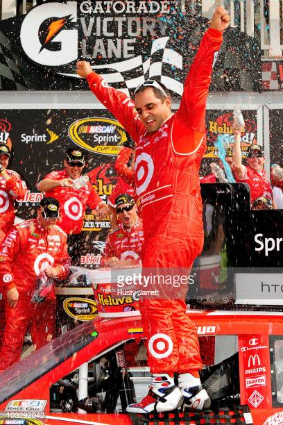 Juan Pablo Montoya driver of the Target Chevrolet celebrates after winning the NASCAR Sprint Cup Series Heluva Good Sour Cream Dips at Watkins Glen...