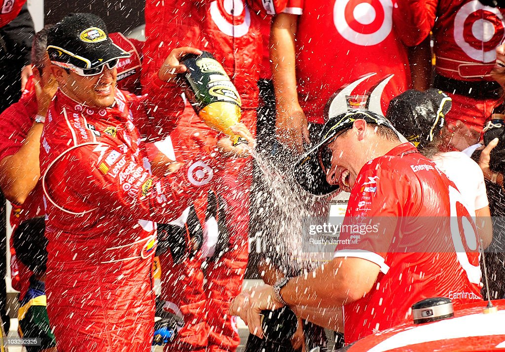 Juan Pablo Montoya (L), driver of the #42 Target Chevrolet, celebrates after winning the NASCAR Sprint Cup Series Heluva Good! Sour Cream Dips at Watkins Glen International on August 8, 2010 in Watkins Glen, New York.