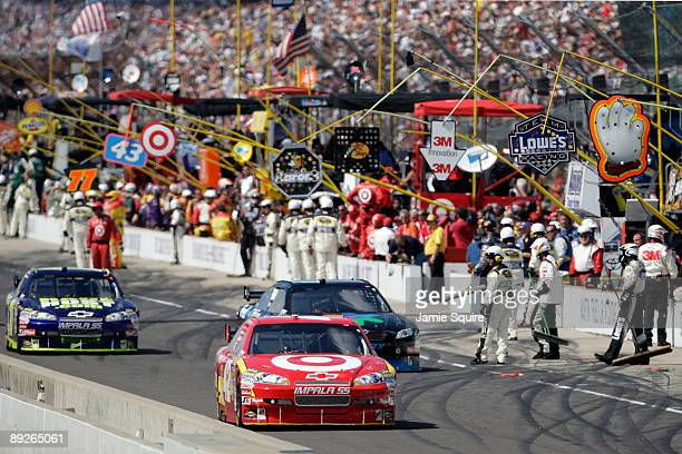 Juan Pablo Montoya driver of the Target Chevrolet is caught for speeding down pit road during the NASCAR Sprint Cup Series Allstate 400 at the...