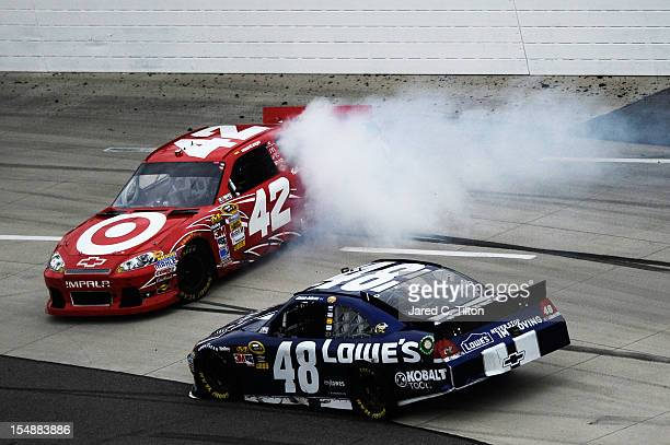 Juan Pablo Montoya driver of the Target Chevrolet is involved in an incident as Jimmie Johnson driver of the Lowe's Chevrolet passes during the...