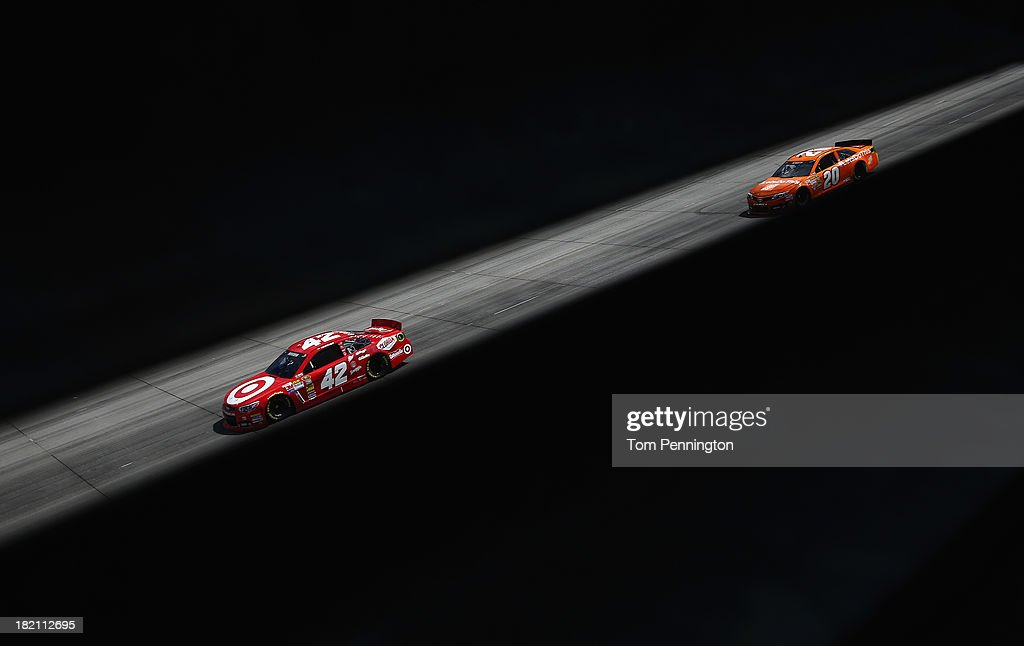 Juan Pablo Montoya, driver of the #42 Target Chevrolet, leads Matt Kenseth, driver of the #20 Home Depot 'Let's Do This' Toyota, during practice for the NASCAR Sprint Cup Series AAA 400 at Dover International Speedway on September 28, 2013 in Dover, Delaware.