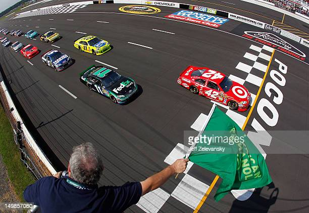 Juan Pablo Montoya driver of the Target Chevrolet leads the field to the green flag to start the NASCAR Sprint Cup Series Pennsylvania 400 at Pocono...
