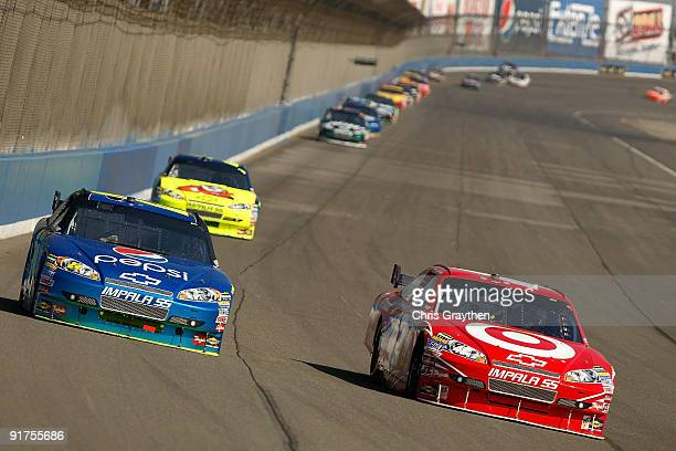 Juan Pablo Montoya driver of the Target Chevrolet races Jeff Gordon driver of the Pepsi Chevrolet during the NASCAR Sprint Cup Series Pepsi 500 at...