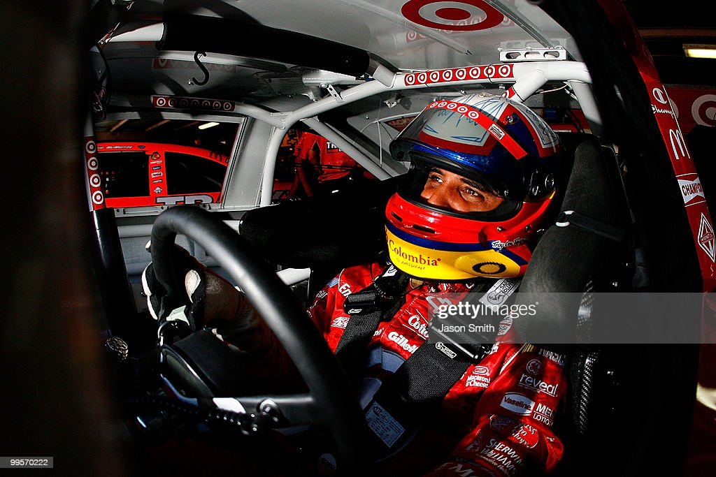 Juan Pablo Montoya, driver of the #42 Target Chevrolet, sits in his car in the garage during practice for the NASCAR Sprint Cup Series Autism Speaks 400 at Dover International Speedway on May 15, 2010 in Dover, Delaware.