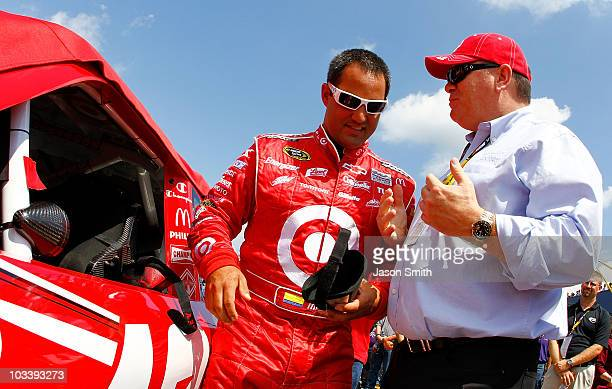 Juan Pablo Montoya driver of the Target Chevrolet talks with team owner Chip Ganassi on the grid during the NASCAR Sprint Cup Series CARFAX 400 at...
