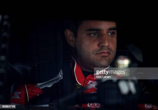 Juan Pablo Montoya driver of the Target Toyota sits in his car during practice for the NASCAR Sprint Cup Series Goody�s Fast Pain Relief 500 at the...
