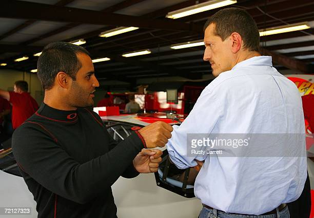 Juan Pablo Montoya driver of the Texaco Havoline Ganassi Racing Dodge speaks with Guenther Steiner VP of Competition for Team Red Bull during NASCAR...