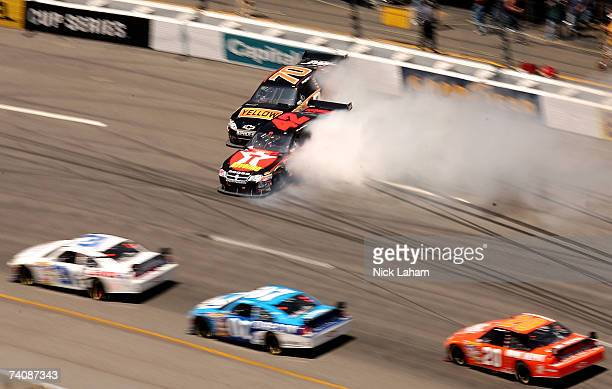 Juan Pablo Montoya, driver of the Texaco/Havoline Dodge, crashes into Johnny Sauter, driver of the Yellow Transportation Chevrolet, during the NASCAR...