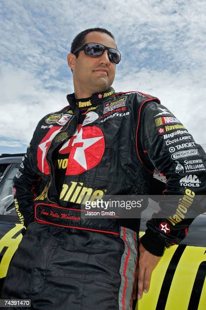 Juan Pablo Montoya driver of the Texaco/Havoline Dodge looks on before the start of the NASCAR Nextel Cup Series Autism Speaks 400 on June 4 2007 at...