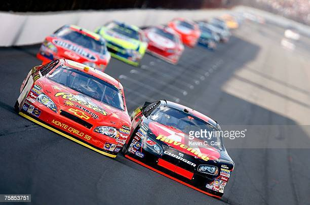 Juan Pablo Montoya driver of the Texaco/Havoline Dodge races Kevin Harvick driver of the Reese's Racing Chevrolet during the NASCAR Nextel Cup Series...