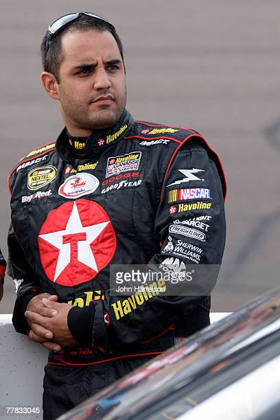 Juan Pablo Montoya driver of the Texaco/Havoline Dodge stands on the grid during qualifying for the NASCAR Nextel Cup Series Checker Auto Parts 500...