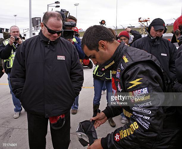 Juan Pablo Montoya driver of the TexacoHavoline Dodge talks with car owner Chip Ganassi before the ARCA RE/MAX Series Prairie Meadows 250 on October...