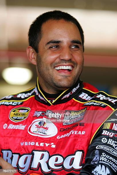 Juan Pablo Montoya driver of the Wrigley's Big Red Dodge stands in that garage prior to practice for the NASCAR Nextel Cup Series Sharp Aquos 500 at...
