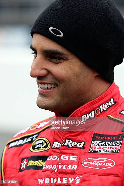 Juan Pablo Montoya driver of the Wrigley's Big Red Dodge stands on the grid prior to the NASCAR Sprint Cup Series Goody's Cool Orange 500 at...