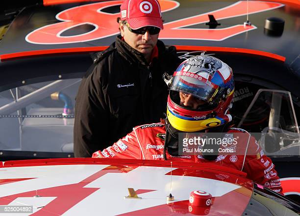 Juan Pablo Montoya exits his car after winning the pole position during qualifying for the NASCAR Sprint Cup Series Auto Club 400.
