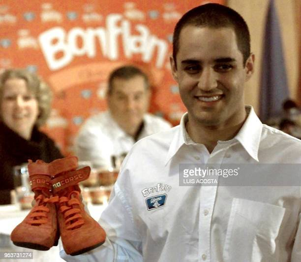 Juan Pablo Montoya Formula 1 pilot of the Williams stable shows 24 March 2001 the pair of boots he wore in Bogota Colombia he will auction them and...