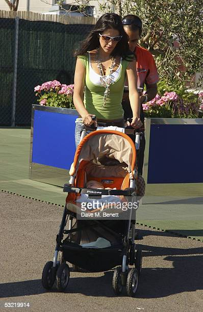 Juan Pablo Montoya his wife Connie Montoya and son Sabastian Montoya attend the Formula One British Grand Prix at Silverstone on July 10 2005 in...
