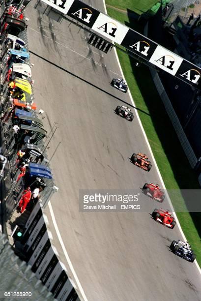 Juan Pablo Montoya leads Michael Schumacher Rubens Barrichello Jos Verstappen David Coulthard and Kimi Raikkonen during the Austrian Grand Prix